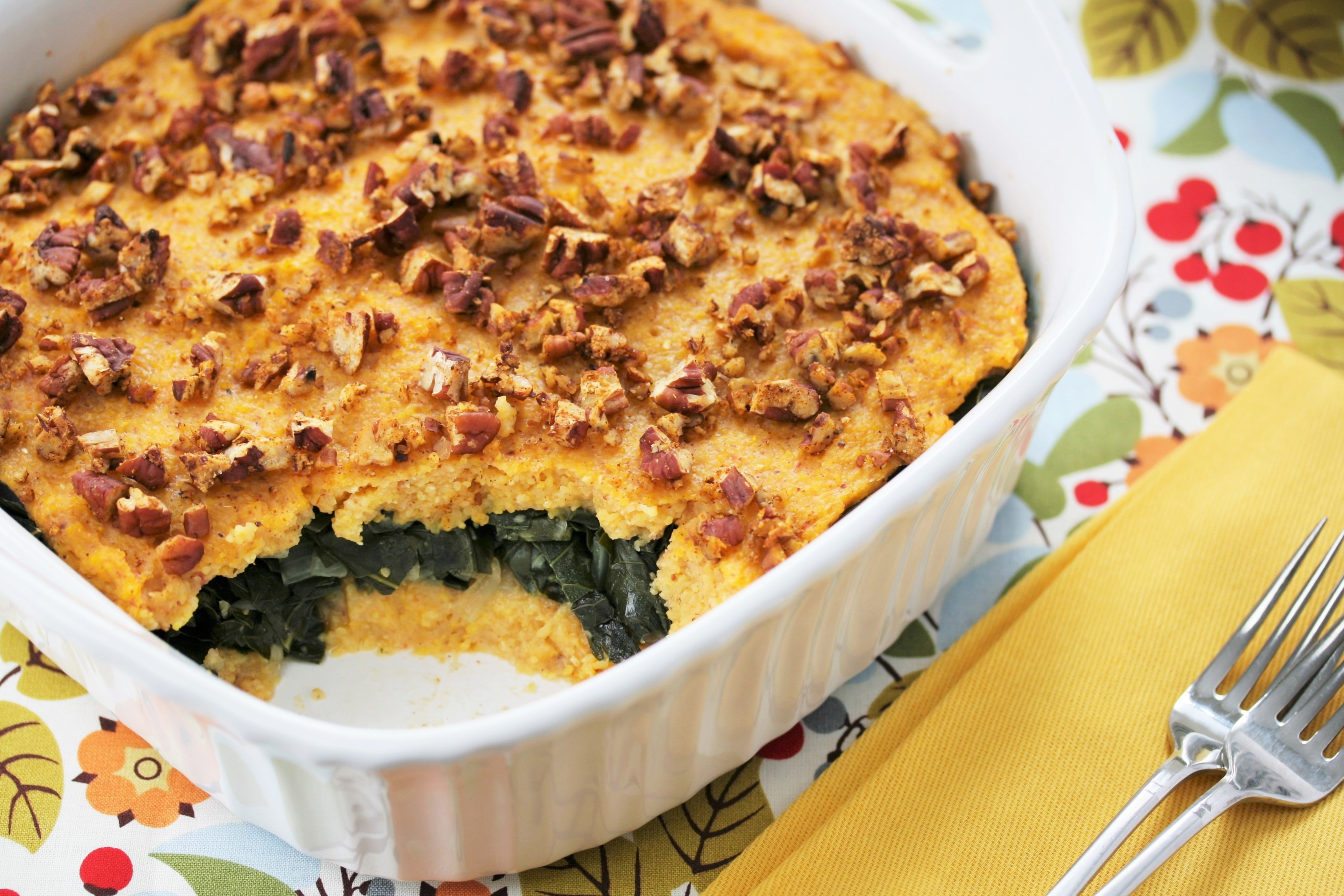 Luscious grits and collard greens casserole topped with spicy Cajun ...