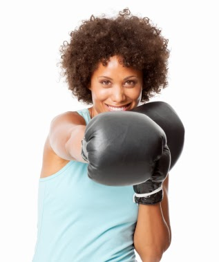Boxing-Woman-Knocking-Out-Breast-Cancer-iStock_000018857857XSmall