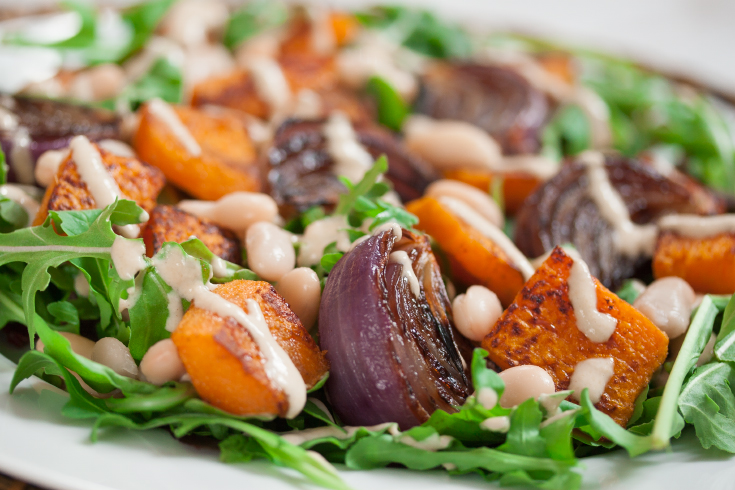 Roasted butternut squash salad with oil-free cashew dressing.