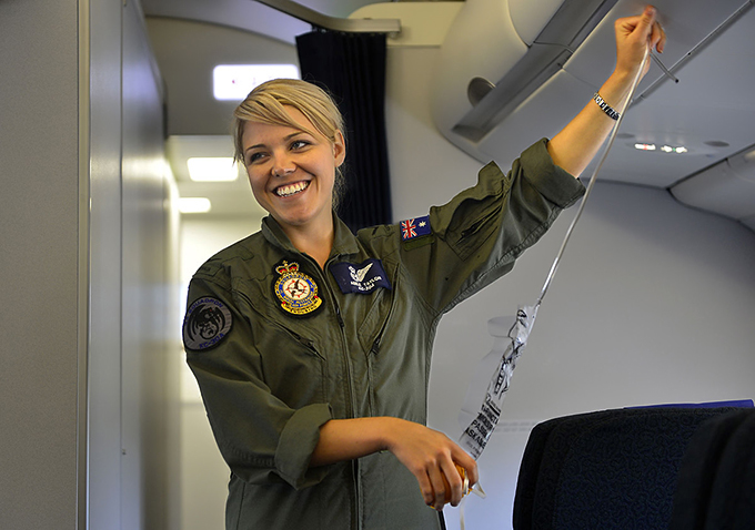 v3-1200px-RAAF_Aircraftswoman_providing_a_safety_brief_onboard_a_KC-30